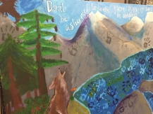 Americorps Service Project in Spring of 2015. Student hand-prints paint a mural to inspire peers and future generations in English and Spanish for Incline Elementary School.